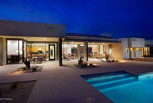 Contemporary Patio with exterior stone floors, French doors
