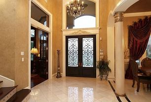 Traditional Entryway with Glass panel door, Sunken living room, High ceiling, Chandelier, Concrete tile
