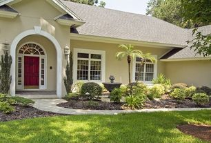 Traditional Landscape/Yard with Transom window, six panel door, Arched window, exterior stone floors, Fountain, Pathway