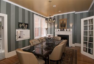 Eclectic Dining Room with interior wallpaper, French doors, Chandelier, Crown molding, Wall sconce, Bamboo floors