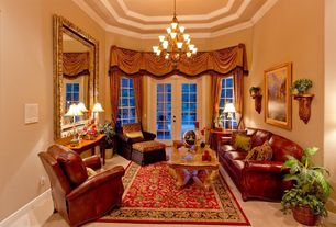 Traditional Living Room with Crown molding, Concrete floors, French doors, Casement, Chandelier, High ceiling