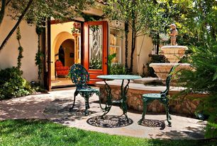 Traditional Patio with Glass panel door, Fountain, exterior stone floors