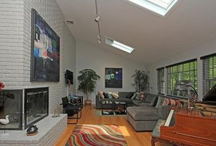 Eclectic Living Room with Light wood floors, Slanted ceiling, Microfiber sectional sofa with chaise, Hardwood floors