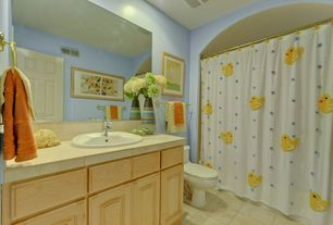 Traditional Kids Bathroom with Vinyl floors, Framed Partial Panel, Complex marble counters, shower bath combo, Full Bath
