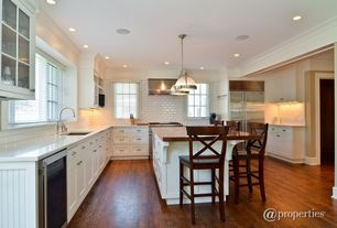 Traditional Kitchen with Soapstone counters, Breakfast bar, Hardwood floors, Kitchen island, Flush, Pendant light, U-shaped
