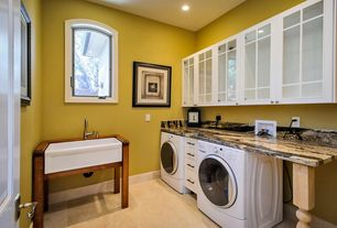 """Eclectic Laundry Room with stone tile floors, Undermount sink, 30"""" baldwin fireclay farmhouse sink - decorative lip, Paint"""