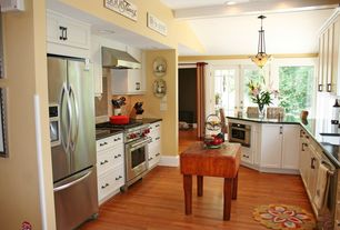 Kitchen with Undermount sink, Flush, Kitchen island, Ceramic Tile, can lights, Flat panel cabinets, Wall Hood, French doors