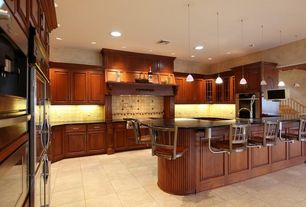Traditional Kitchen with Breakfast bar, Pendant light, Custom hood, U-shaped, Large Ceramic Tile, High ceiling, Raised panel