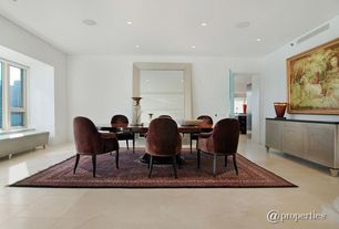 Contemporary Dining Room with Concrete tile , can lights, Casement, Standard height, Carpet, specialty window