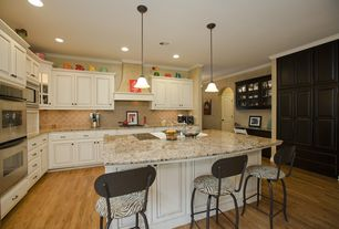 Eclectic Kitchen with L-shaped, Simple granite counters, Oak - Spice 2 1/4 in. Solid Hardwood Strip, Crown molding