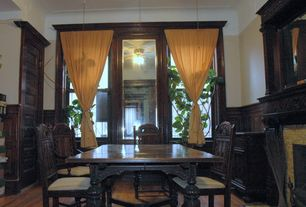 Traditional Dining Room with Hardwood floors, High ceiling, Wainscotting