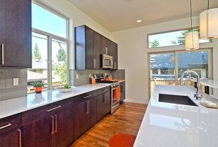 Contemporary Kitchen with Kitchen island, full backsplash, Stainless Steel, One-wall, Flush, Casement, High ceiling
