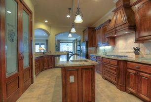 Traditional Kitchen with Flat panel cabinets, Galley, Custom hood, Large Ceramic Tile, Pendant light, Vinyl floors