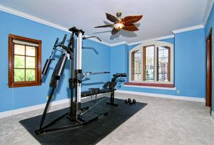 Traditional Home Gym with Crown molding, flush light, Arched window, Ceiling fan, Carpet