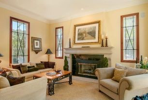 Traditional Living Room with Fireplace, double-hung window, Carpet, Standard height, stone fireplace, Crown molding