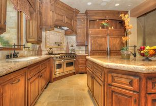 Traditional Kitchen with Simple granite counters, Large Ceramic Tile, Raised panel, Glass panel, Kitchen island, Custom hood
