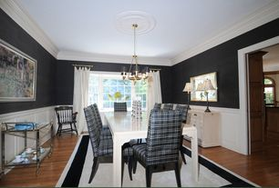 Traditional Dining Room with Bay window, Crown molding, Chandelier, Standard height, Chair rail, Wainscotting