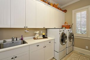 Country Laundry Room with Crown molding, Undermount sink, Standard height, Casement, laundry sink, travertine floors