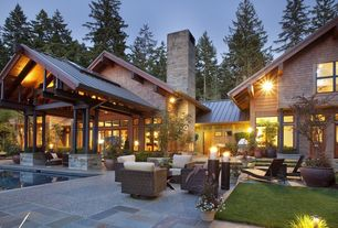 Contemporary Patio with Glass panel door, exterior stone floors, Cedar shingle siding, Exterior accent lighting