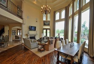 Mediterranean Great Room with French doors, Columns, High ceiling, Chandelier, Transom window, Hardwood floors