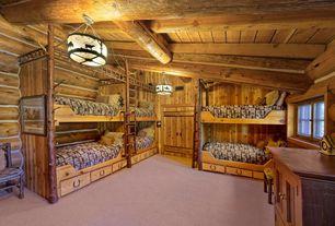 Rustic Guest Bedroom with Built-in bookshelf, Concrete floors, flush light, Box ceiling, specialty door