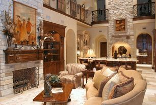 Mediterranean Great Room with Built-in bookshelf, Loft, Cathedral ceiling