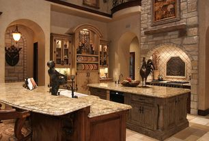 Mediterranean Kitchen with Complex granite counters, High ceiling, Arched doorway, Glass panel, Raised panel, L-shaped
