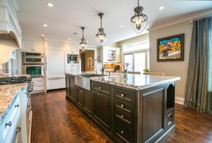 Traditional Kitchen with Breakfast bar, Kitchen island, Crown molding, Pendant light, L-shaped, Farmhouse sink, French doors