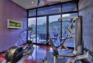 Contemporary Home Gym with High ceiling, Hardwood floors, Ceiling fan, Transom window