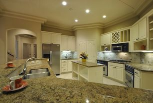 Traditional Kitchen with wall oven, Built-in bookshelf, Built In Refrigerator, electric cooktop, dishwasher, can lights