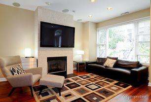 Modern Living Room with Fireplace, Casement, metal fireplace, Laminate floors, Standard height, can lights