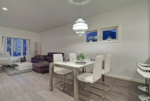 Contemporary Great Room with Laminate floors, Carpet, specialty window, can lights, Ceiling fan, Standard height