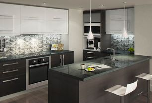 Contemporary Kitchen with Standard height, Galley, can lights, built-in microwave, full backsplash, Pendant light, Glass Tile