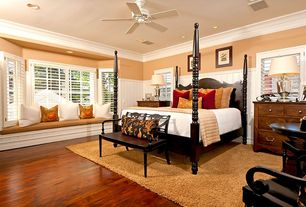 Traditional Guest Bedroom with Standard height, can lights, Window seat, Bay window, Crown molding, Hardwood floors