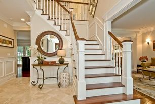 Traditional Staircase with Wainscotting, limestone floors, High ceiling