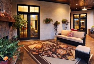 Craftsman Porch with Ceiling fan, French doors, Concrete floors, High ceiling, stone fireplace, Crown molding, Transom window