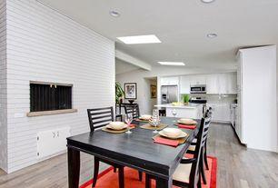 Contemporary Dining Room with Built-in bookshelf, Skylight, Chandelier, Carpet, Standard height, Laminate floors