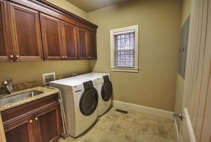 Craftsman Laundry Room with Built-in bookshelf, Undermount sink, travertine floors, specialty door