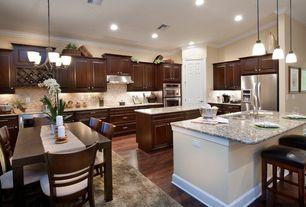 Traditional Kitchen with Stonemark Granite-Granite Countertop in St. Cecilia Classic, Pendant light, Breakfast bar, Flush