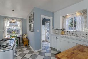 Traditional Kitchen with Vinyl floors, Breakfast nook, U-shaped, Holsag Bulldog Side Chair, Large Ceramic Tile, Pendant light