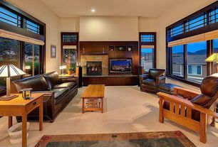 Craftsman Living Room with Carpet, double-hung window, can lights, picture window, insert fireplace, Built-in bookshelf