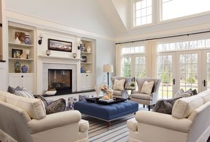 Traditional Living Room with Wall sconce, Fireplace, insert fireplace, Paint 2, Built-in bookshelf, Cathedral ceiling