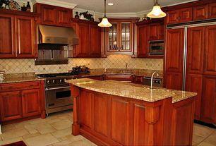 Craftsman Kitchen with Pendant light, stone tile floors, can lights, Flush, Raised panel, gas range, Simple granite counters