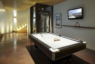 Contemporary Game Room with High ceiling, Concrete floors, Glass panel door