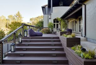 Contemporary Deck with exterior tile floors, Outdoor beanbag lounger, Outdoor floor lanterns, French doors