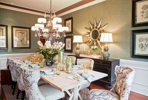 Traditional Dining Room with Crown molding, can lights, Hardwood floors, Chandelier, Standard height, Wainscotting