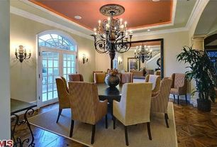 Eclectic Dining Room with Wall sconce, Hardwood floors, French doors, Standard height, Transom window, Crown molding