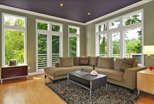 Contemporary Living Room with French doors, Hardwood floors, Crown molding