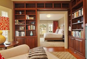 Traditional Master Bedroom with Built-in bookshelf, Laminate floors, flush light