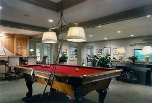Contemporary Basement with Carpet, Columns, can lights, High ceiling, Pendant light, Built-in bookshelf